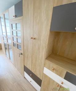 隱藏式門鉸令房門完美地融合在櫃體之中